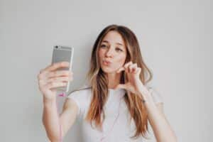 Young girl with mobile phone are making social media content, online calling, Instagram content